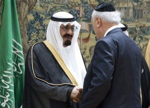 (Photo: AP Images / Victor R. Caivano) King Abdullah of Saudi Arabia, left, shakes hands with Rabbi Arthur Schneier of the Park East Synagogue of New York City, right, during the World Conference on Dialogue at the Pardo Palace in Madrid, Wednesday, July 16, 2008. King Abdullah of Saudi Arabia exhorted followers of the world's leading faiths to turn away from extremism and embrace a spirit of reconciliation, saying at the start of an interfaith conference Wednesday that history's great conflicts were not caused by religion itself but by its misinterpretation.