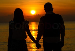 5763865-284616-couple-of-lover-holding-hand-with-sunrise