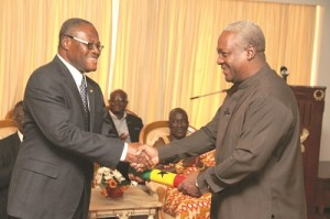 President Mahama presenting the scroll of office to Mr Bebaako-Mensah at the Flagstaff House yesterday. Picture: EBOW HANSON