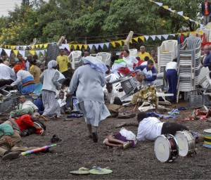 Wounded churchgoers lie on the ground as Roman Catholic nuns run for cover after a blast at the St. Joseph Mfanyakazi Roman Catholic church in Arusha, Tanzania Sunday, May 5, 2013. Police said At least 30 people were injured, three seriously, in the suspected bomb attack AP PHOTO