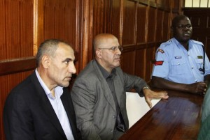 """Associated Press/Khalil Senosi - Kenyan police escort two Iranian nationals Ahmed Abolfathi Mohammed, centre, and Sayed Mansour Mousavi, left, as they await judgement inside the magistrate court in Nairobi, Kenya, Monday, May 6, 2013. The two men were convicted of plotting attacks against western and Israeli targets, to life in prison. The two Iranian nationals Ahmad Abolfathi Mohammad and Sayed Mansour Mousavi were arrested in June 2012, and prosecutors said the two had explosives """"in circumstances that indicated they were armed with the intent to commit grievous harm, and they are suspected of involvement in attacks, or thwarted attacks, around the globe, including in Azerbaijan, Thailand and India. (AP Photo/Khalil Senosi)"""