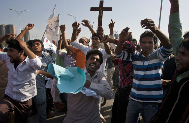 Associated Press/Anjum Naveed - Pakistani Christians chant slogans during a demonstration demanding that the government rebuild their homes after they were burned down following an alleged blasphemy incident, in Islamabad, Pakistan, Sunday, March 10, 2013. The incident in Lahore began on Friday, March 8, 2013 after a Muslim accused a Christian man of blasphemy, an offence that in Pakistan is punished by life in prison or death. (AP Photo/Anjum Naveed)