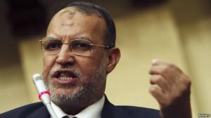 FILE - Essam el-Erian, deputy head of the Freedom and Justice Party, speaks during Egypt's Shura Council meeting in Cairo, May 25, 2013.