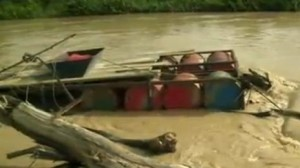 Illegal miners use makeshift barges to dredge river beds