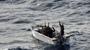 The six Somali pirates in a small motor boat surrender  The Somali pirates surrendered after being pursued by a naval helicopter