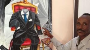 The Somali artist Affey with his painting 'Empty Suit' representing diaspora politicians, Mogadishu, Somalia. (Gabe Joselow/VOA)