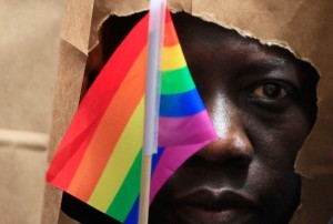 An asylum seeker from Uganda covers his face with a paper bag in order to protect his identity as he marches with the LGBT Asylum Support Task Force during the Gay Pride Parade in Boston on June 8, 2013.