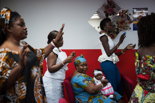 Worshipers, including many from Africa, at the Holy Fire Dynamic Word church in the Bronx. Credit Damon Winter/The New York Times