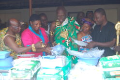 Nana OtutuKono III, Nifahene of Akuapem, takes delivery of Medical Equipment and Supplies