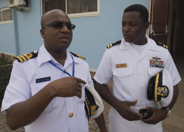 150327-N-QY759-0008 ACCRA, Ghana (March 27, 2015) Lt. Maxwell Annani, right, speaks with his Ghanaian counterpart before the Exercise Obangame Express closing ceremony March 27, 2015. Obangame Express is a U.S. Africa Command-sponsored multinational maritime exercise designed to increase maritime safety and security in the Gulf of Guinea. (U.S. Navy photo by Mass Communication Specialist 1st Class David R. Krigbaum/Released)