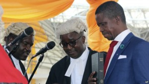 FILE - The Patriotic Front's Edgar Lungu, right, is sworn in as president at an inauguration ceremony in Lusaka, Jan. 25, 2015.