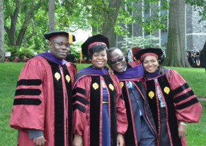 From left: Fordham Law graduates and Ghanaian nationals Alexander Tutu Osei, Afi Agbanu Kudomor, George Buadi, and Mariama Sammo. Photo by Chris Gosier
