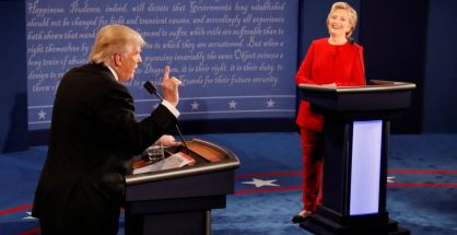 Republican U.S. presidential nominee Donald Trump speaks as Democratic U.S. presidential nominee Hillary Clinton listens during their first presidential debate at Hofstra University in Hempstead, New York, U.S., September 26, 2016.              REUTERS/Rick Wilking   TPX IMAGES OF THE DAY - RTSPKQH
